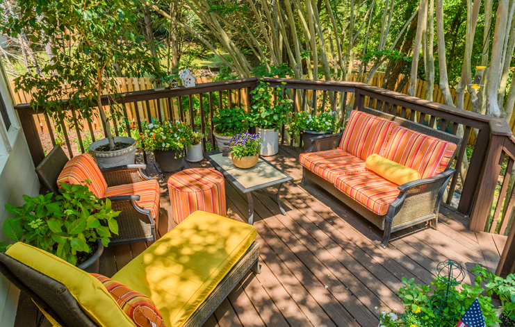 Brightly upholstered patio furniture on wooden deck